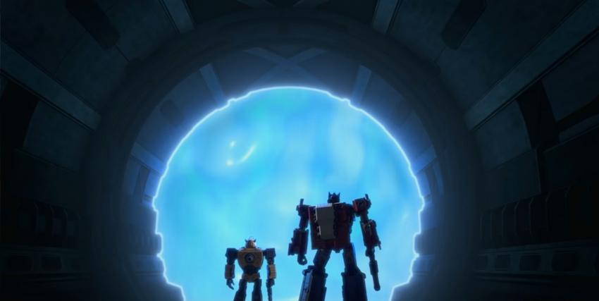 optimus prime e bumblebee sono davanti a un portale circolare e azzurro: cosa ci sarà dall'altra parte? - nerdface