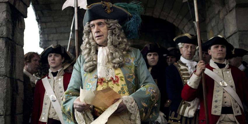 jonathan pryce con parrucca e abiti di scena nel film i pirati dei caraibi - nerdface