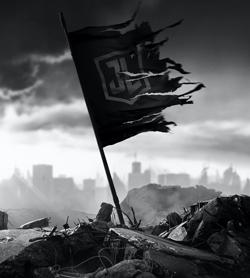 La bandiera con il logo della Justice League che sventola sopra delle macerie - nerdface