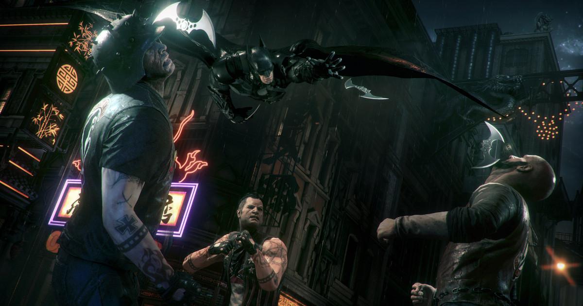 Batman si scaglia planando contro dei nemici - nerdface