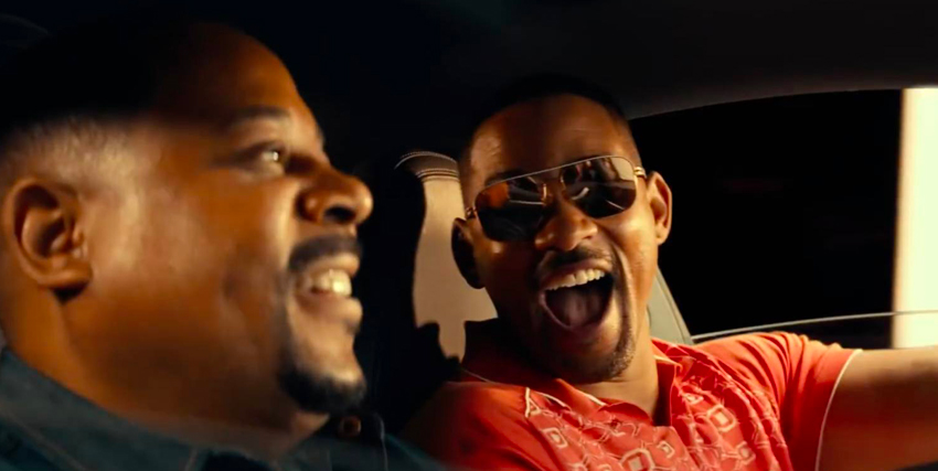 i due protagonisti sono in auto e will smith sorride all'amico - nerdface