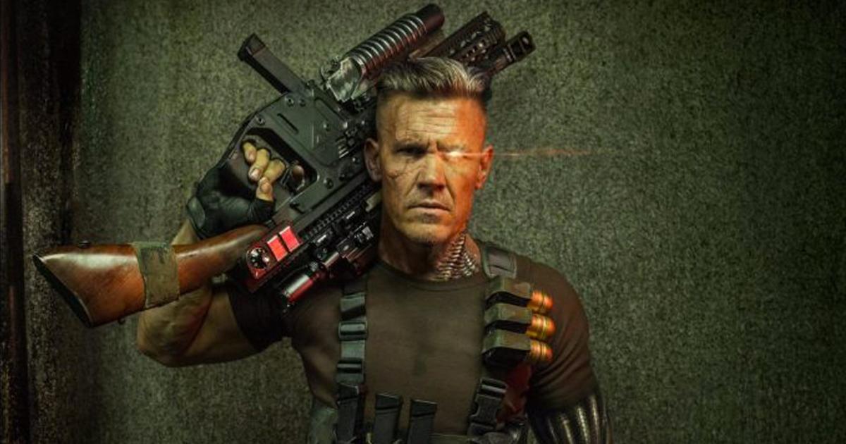Primo piano di Josh Brolin con un arma da fuoco in mano nel film Deadpool 2 - nerdface