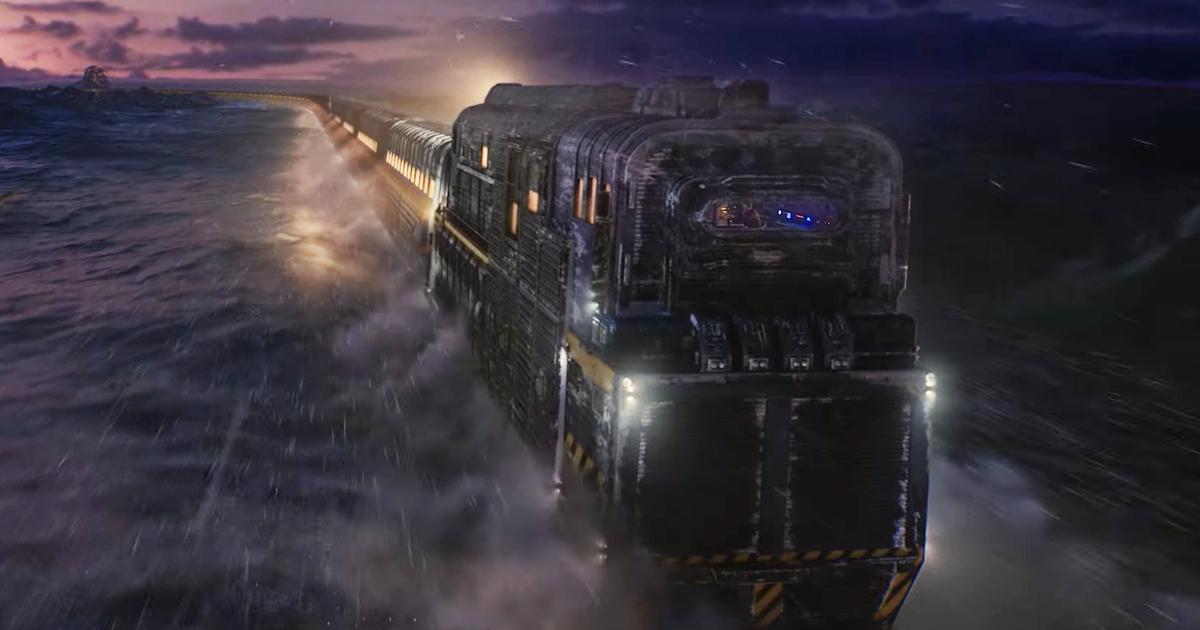 il treno di snowpiercer procede sui binari tagliando la notte e la neve - nerdface